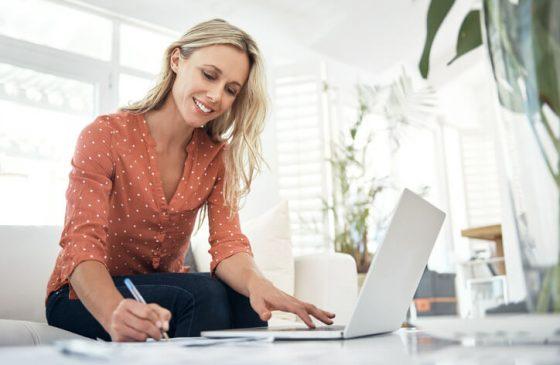 Woman At Computer Writing